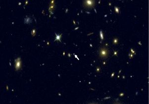 Galaxy COSMOS-1908, indicated by the arrow