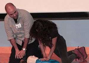 Ruben Santana, an emergency medical technician, guided a student in performing CPR