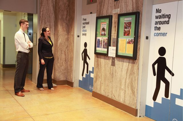People see signs encouraging them to take the stairs for exercise