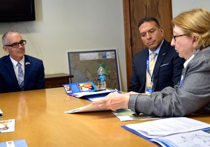 L.A. City Councilman Mitch O'Farrell listens to Stephanie Landregan.