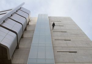 Man walking down Broad Art Center