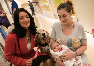 Johnese Spisso, a volunteer dog, baby and mother