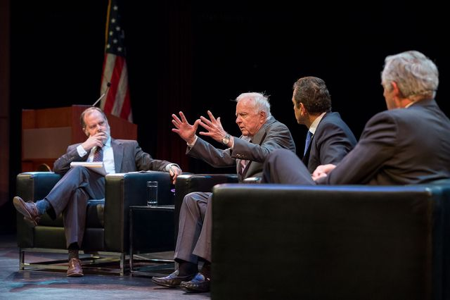All sitting in a row on a stage, Jim Newton interviews three former mayors of Los Angeles