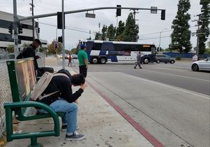Bus and bus stop at Los Angeles intersection