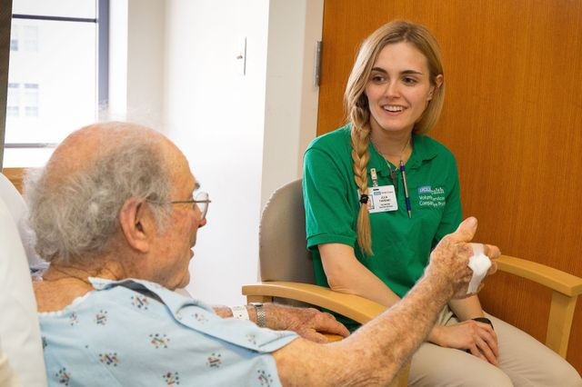 Volunteer companion Julia Torrano and a patient