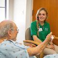 Volunteer companion Julia Torrano and a patient