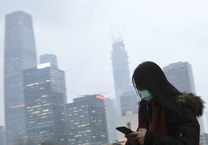 Woman wearing mask in Beijing