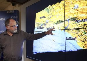 Caltech seismologist with earthquake map