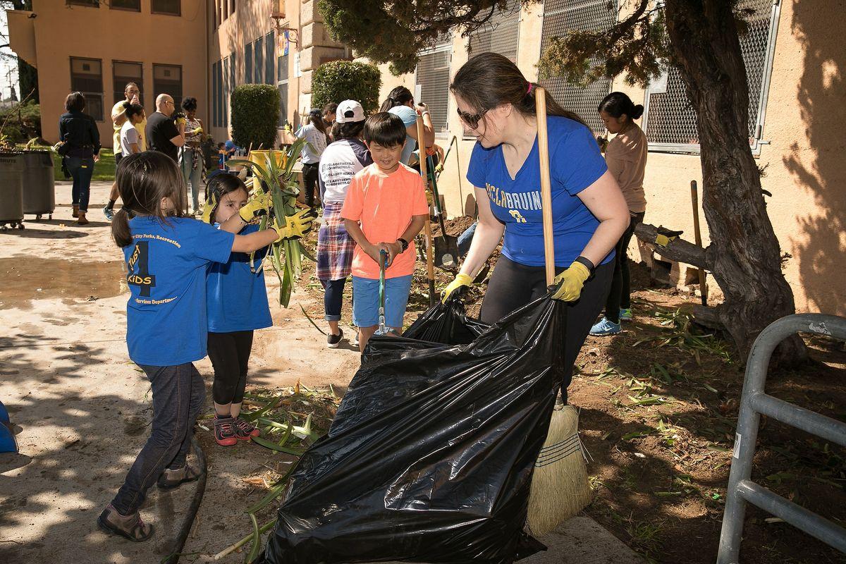 Volunteers work at the Mann UCLA Community School beautification