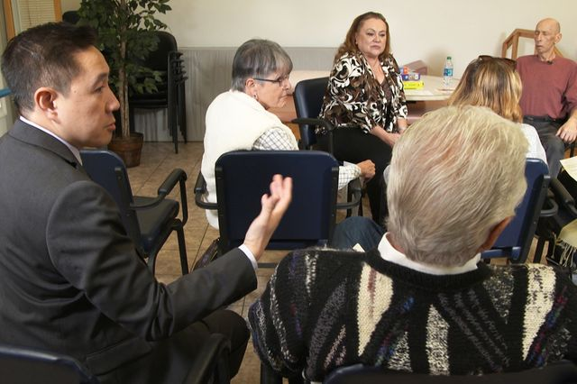 Dr. Zaldy Tan gives feedback to caregivers during a role-playing session at UCLA Health's Alzheimer's Caregiver Boot Camp.