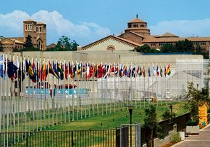 Olympic flags of participating nations fly at UCLA
