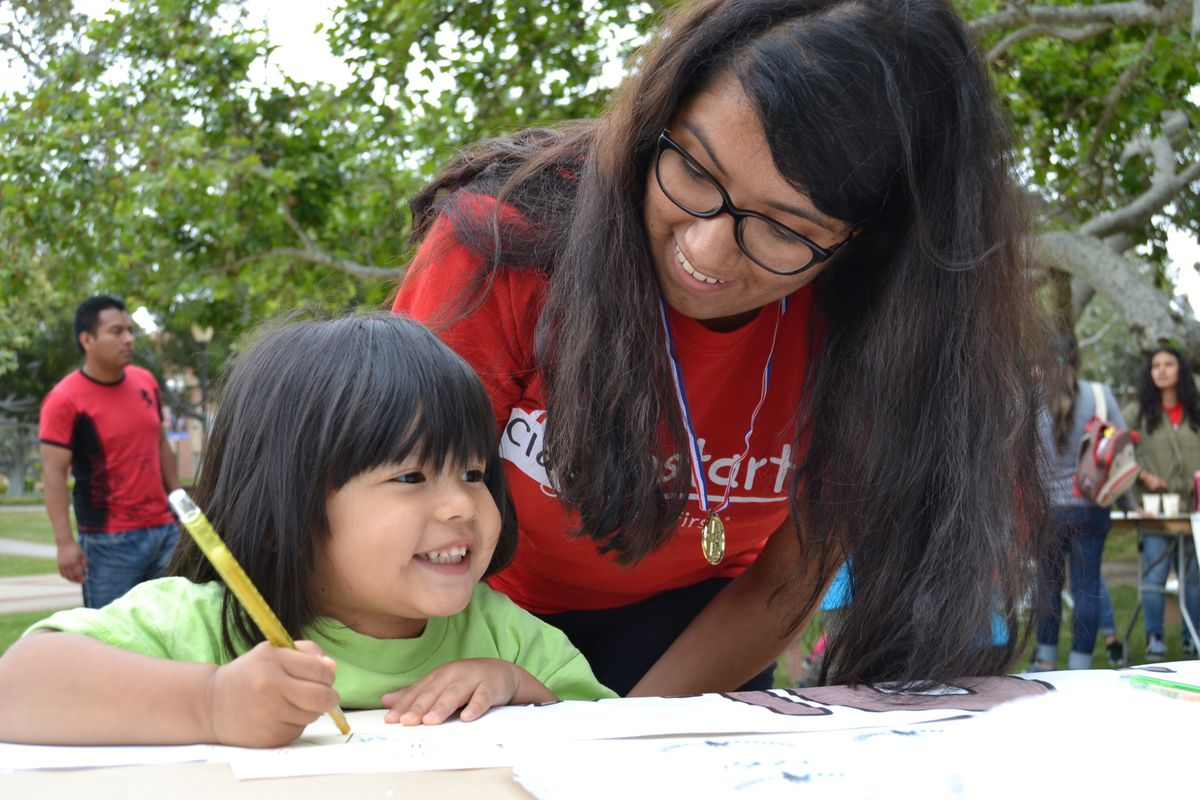 Jumpstart UCLA student and a preschooler