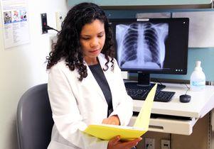 Dr. Edna Elvira Biddy reviews a patient's chart