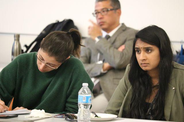 Medical students Samantha Mohammad, left, and Abhinaya Narayanan take notes during the social work orientation.