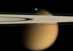 Titan with Saturn's rings