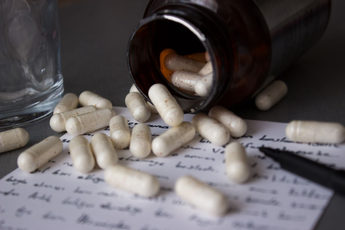 Pills, pill bottle and note