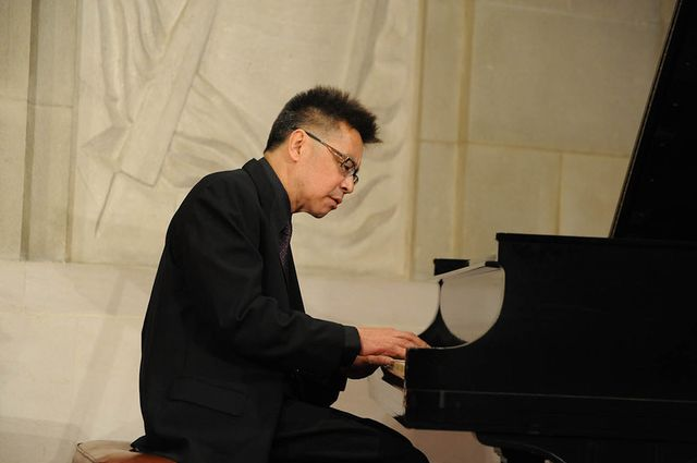 Jon Jang playing piano
