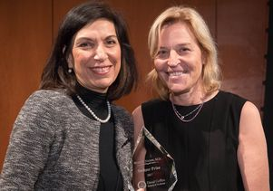 Dr. Huda Zoghbi (left), a Baylor College of Medicine professor, receives the Switzer Prize from Dr. Kelsey Martin, dean of the David Geffen School of Medicine at UCLA.