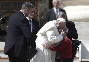 Pope hugs child