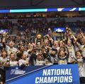 UCLA gymnastics with NCAA trophy