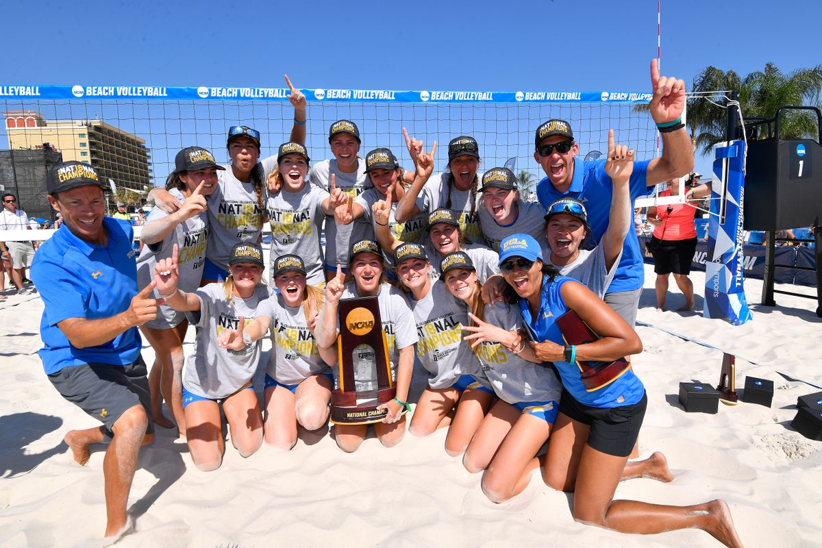 UCLA volleyball team with trophy