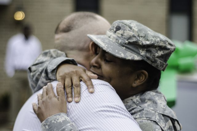Hugging National Guard member
