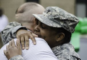 <em>Georgia National Guard</em><br>National Guard Spc. Yolanda Goodman hugs John Davis after Davis' company helped provide Goodman with a new car.