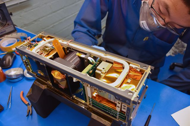 Ethan Tsai works on the flight model assembly for the CubeSat ELFIN.