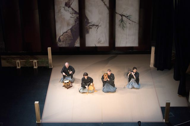 Still from the play Blue Moon Over Memphis, which features four people sitting on a spartan stage