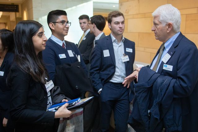 Students talking with Chancellor Gene Block during the D.C. trip