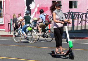 Woman riding Lime scooter