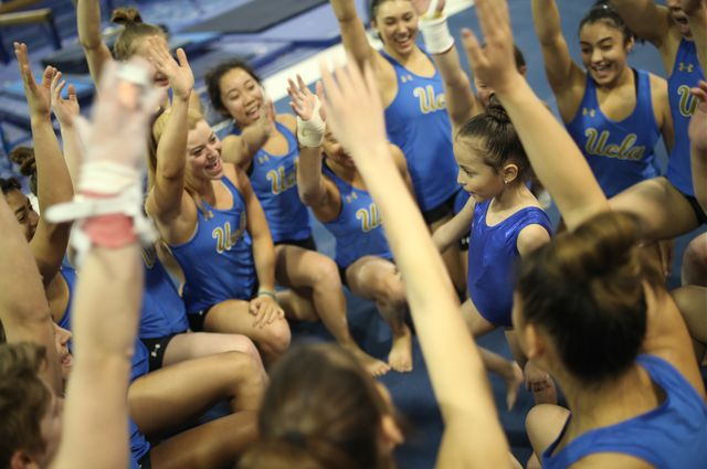 6-year-old Joselin Palma with the UCLA gymnastics team.