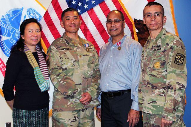 Victoria Sanelli, Maj. Steve Kwon, Romeo Miguel and Maj. Tyrone Vargas.
