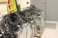 CARC staff will work over the next several months to connect the many cables that will bring the 12-rack, 120-node, 960-core Ulam supercomputer to life.