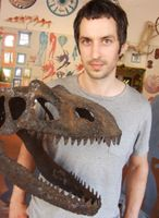 John Grady and replica dinosaur