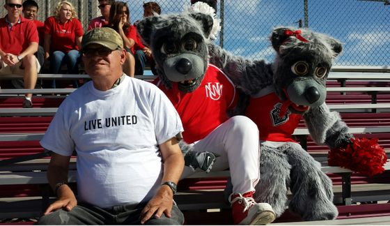 UW recipient with UNM mascots