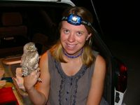 Kirsten Cruz-McDonnell with a Burrowing Owl