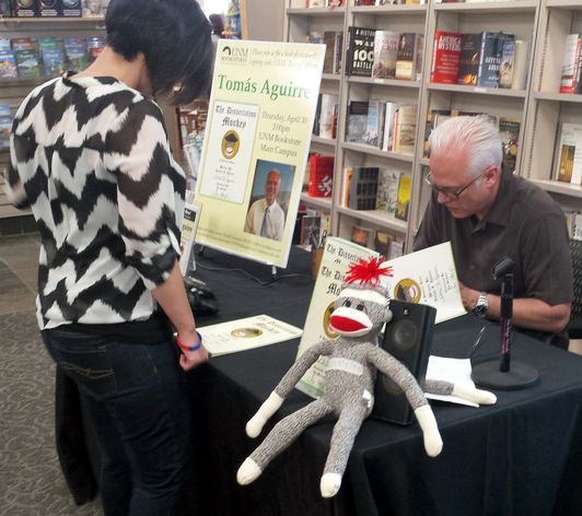 Dean of Students Tomás Aguirre booksigning
