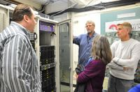 UNM team members Hays Barrett, Karl Benedict and John Savickas show the EPSCoR server, housed at the Earth Data Analysis Center to National Science Foundation officer Augrey Levine.