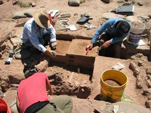 (clockwise from bottom) Jacque Kocer, Gary Hartley and Joe Birkmann working at excavation site