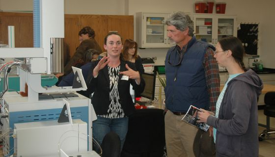 Student explains research at UNM-CSI grand opening