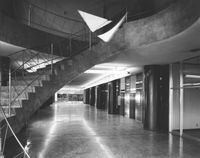 A view of the spiral staircase inside the Simms Building in 1955.
