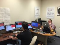 UNM graduate students work on code in computer lab.