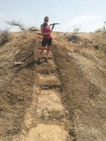 Samantha Ascoli standing in geological trench in study area in Illeret, Kenya.