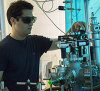 Ph.D. student working in optics lab