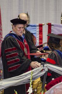 Frank greets graduate