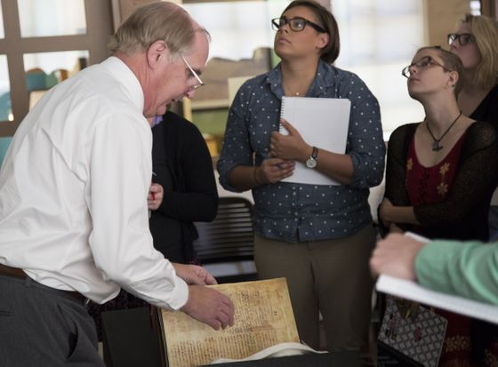 Professor Timothy Graham handling a facsimile