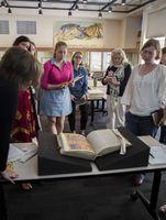 Students study replica manuscript