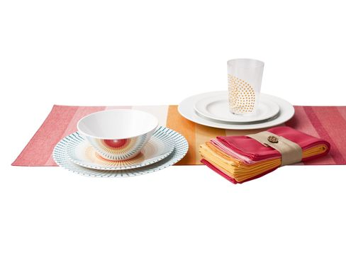 Red Solera Starbust Melamine Dishes, Dot Tumblers in Yellow, White Round Bead 16-piece Dinnerware Set, Solera Striped Table Runner in Warm Tones, and Solera 4-pack Napkins in Warm Tones