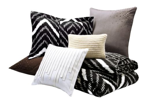 Nate Berkus Mini Nepal Chevron Duvet Set in Onyx (full/queen,) Nate Berkus Saville Row Pillow in White, Nate Berkus Chunky Knit Pillow in Cream with Gold-Detailing, and Nate Berkus Scattered Stud Pillow in Charcoal and Chocolate